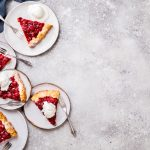 Bakery products. Summer pie with berries. Galeta with cherry sprinkled with powdered sugar. Copy space.